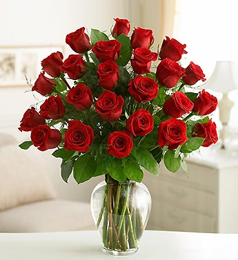 red roses in clear vase