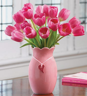 pink tulips in pink vase with heart charm