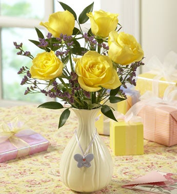 yellow roses in a birthstone vase