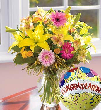 mixed vase arrangement with congratulations mylar